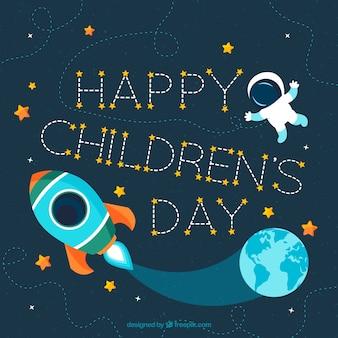 Il giorno dei bambini felici con un astronauta e un razzo