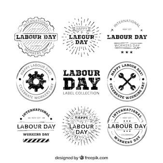 Insieme di mano disegnato loghi Festa del Lavoro