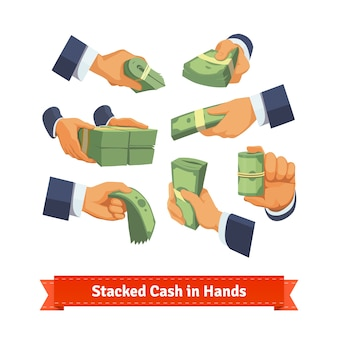 La mano pone dando, prendendo o mostrando pile di denaro