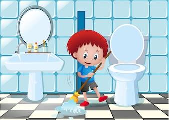 Little boy pulizia pavimento del bagno