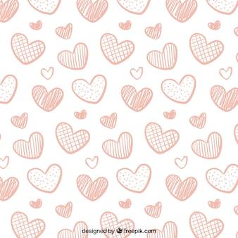 Modello disegnato a mano di cuori decorativi rosa per San Valentino
