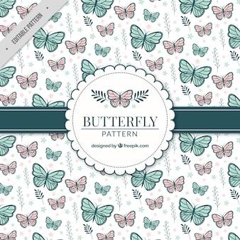 Motivo decorativo con le farfalle e piante