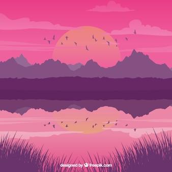 Paesaggio con lago al tramonto e gli uccelli
