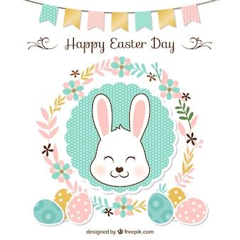 Pasqua sfondo floreale con ghirlanda e coniglio carino