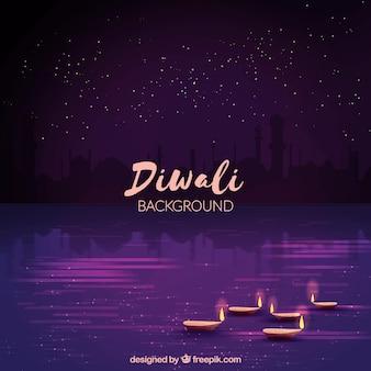 Primo sfondo viola di diwali con candela