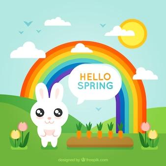 Priorità bassa della sorgente con il coniglietto e arcobaleno nel design piatto