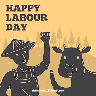 Priorità bassa di giorno di lavoro felice con toro e agricoltore
