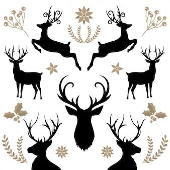 Priorità bassa floreale con le renne