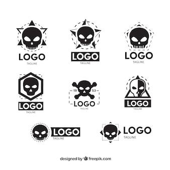 Raccolta di otto loghi cranio in design piatto