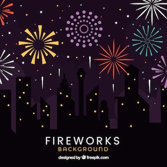 Sagome di edifici con sfondo fuochi d'artificio