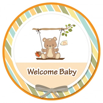 Scheda doccia bambino con orsacchiotto in un altalena