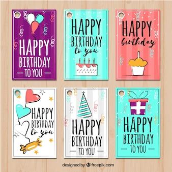 Set di felici cartoline di compleanno con disegni