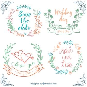 Set disegnata a mano di nozze cornici con decorazione floreale