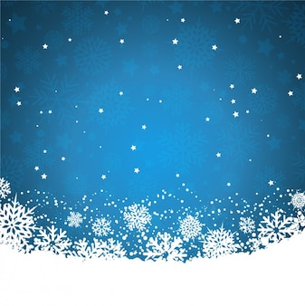 Sfondo blu con fiocchi di neve e stelle