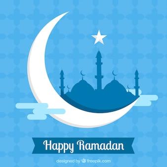 Sfondo blu ramadan con la luna e la moschea