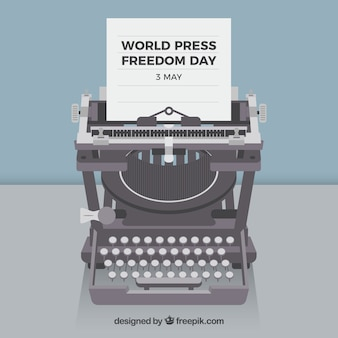 Sfondo con stampa mondiale giornata macchina da scrivere