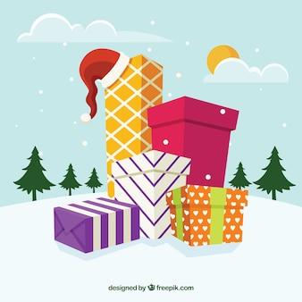 Sfondo di paesaggio nevoso con scatole regalo