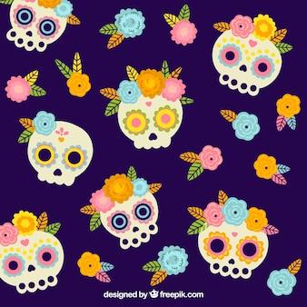 Sfondo di teschi messicani con fiori