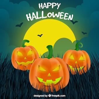Sfondo di tre zucche di Halloween malvagio