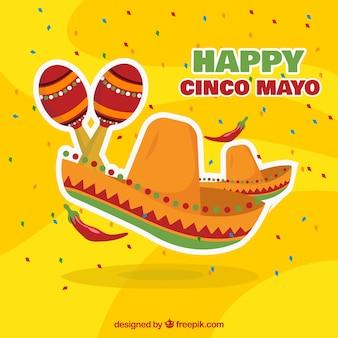 Sfondo giallo con cappello messicano e maracas