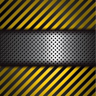 Sfondo metallico perforato con strisce di avvertimento giallo e nero