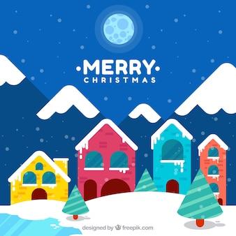 Sfondo Natale con villaggio di montagna carino