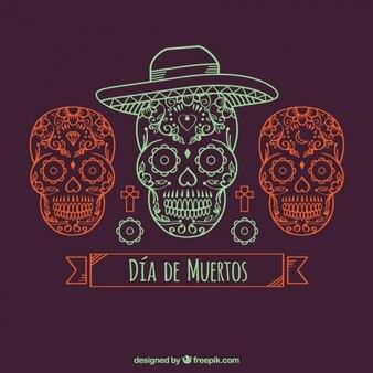 Sfondo ornamentale con tre teschi messicani disegnati a mano