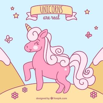 Sfondo rosa unicorno disegnato a mano