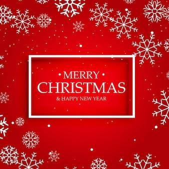 Sfondo rosso di Buon Natale con i fiocchi di neve