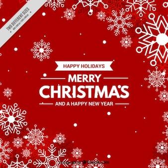 Sfondo rosso di Natale con i fiocchi di neve