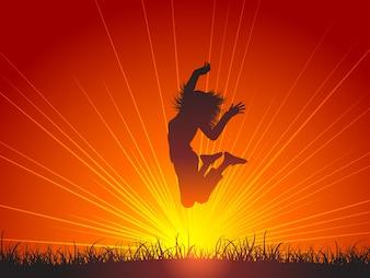 Silhouette di salto femminile per gioia