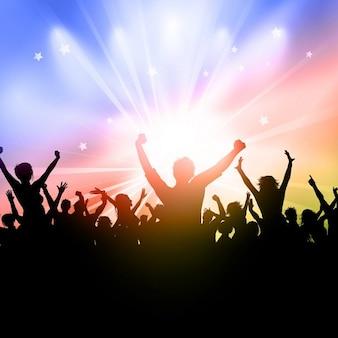 Silhouette di una folla di partito su uno sfondo starburst