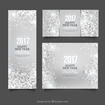 Striscioni e depliant d'argento di festa del nuovo anno