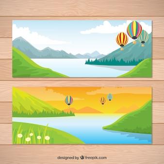 Striscioni paesaggio con lago e palloncini