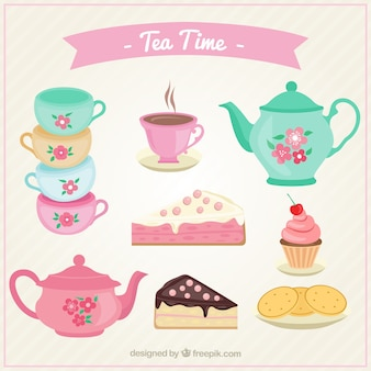 Tazze da tè svegli impostati con torte