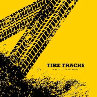 Tracce di pneumatici segni su sfondo giallo grunge
