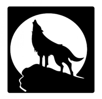 Ululato del lupo silhouette e la luna piena