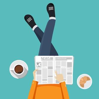 Uomo che legge giornale