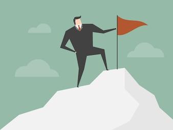 Uomo d'affari sulla cima di una montagna