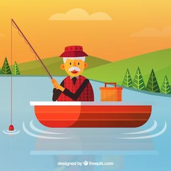 Vecchio uomo che pesca in uno sfondo della barca
