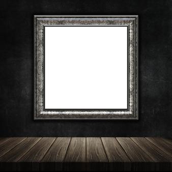 3D geef van een grunge fotolijst met een houten tafel tegen een grunge metal background