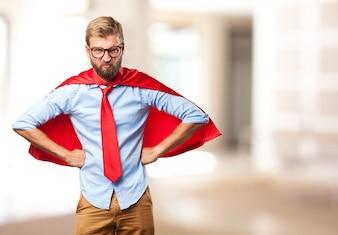 Almachtige executive met rode cape