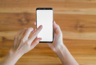 Bedrijfs hand met mobiele telefoon.
