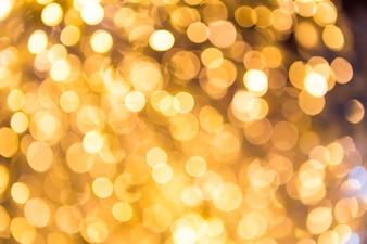 Bokeh onscherpe gouden abstracte achtergrond van Kerstmis