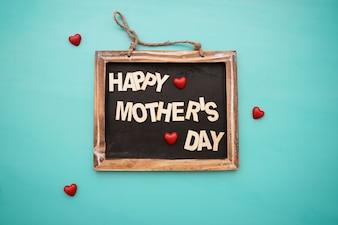 Bord met de dag van de gelukkige moeder belettering