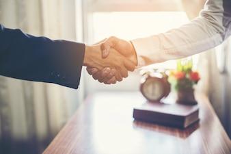 Business team handshake succes.