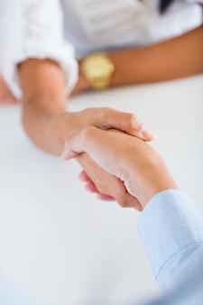 Een corporate handdruk