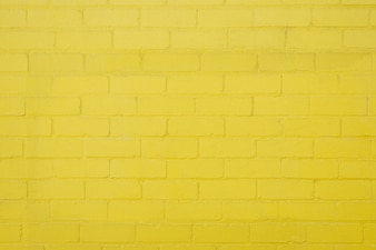 Gele bakstenen muur achtergrond textuur