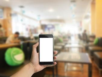 Hand houden telefoon met klantenservice kamer achtergrond