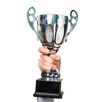 Hand van de man die een trofee houdt